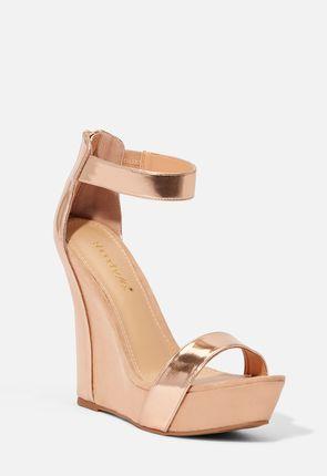 5a99a3deec9 Ebani sandaler med kilklack ...